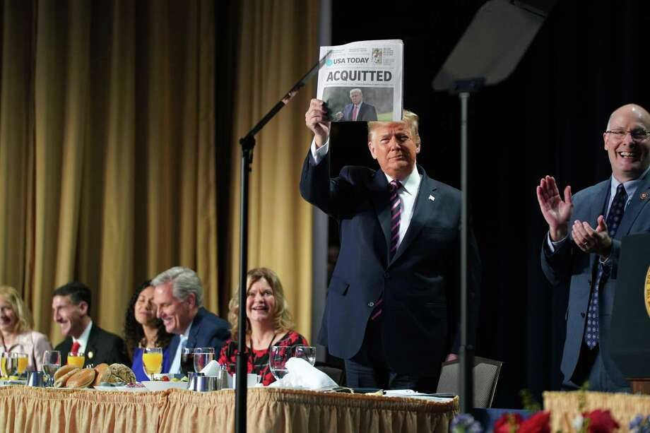 President Donald Trump displays a newspaper reporting his Senate acquittal as he arrives at the National Prayer Breakfast last week. Two readers respond to Trump's speech at the breakfast. Photo: Anna Moneymaker /New York Times / NYTNS