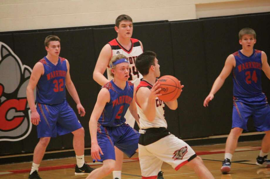 Chippewa Hills' Sam Cole (2) guards Reed City's Zac Saez in action earlier this season. (Pioneer photo/John Raffel)