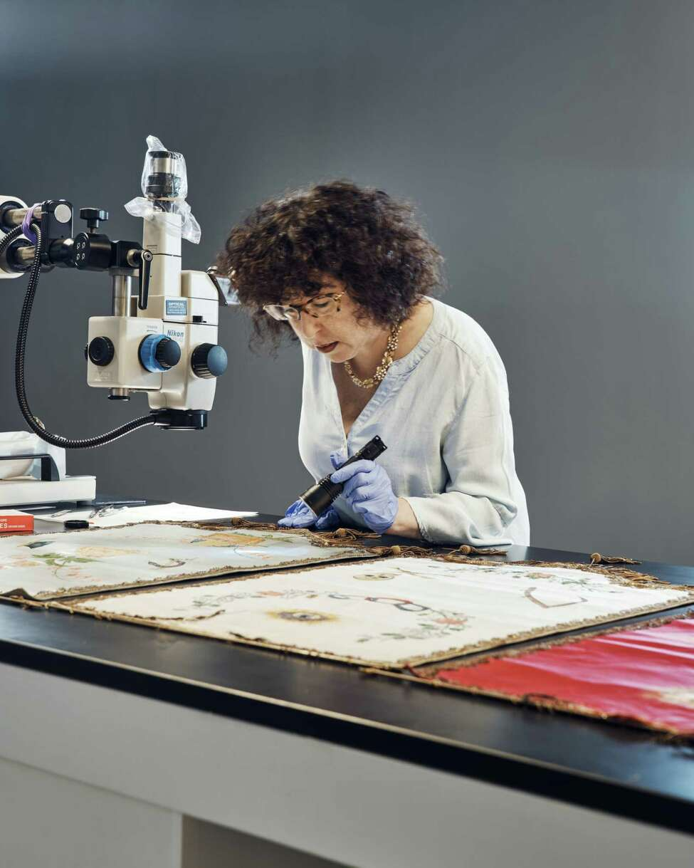 FILE A?' Jennifer Mass, president of the Scientific Analysis of Fine Art lab, examines old paint in New York on Aug. 26, 2019. The art world is increasingly turning to scientific analysis of pigments to find out how time has changed some famous paintings. (Thomas Prior/The New York Times)