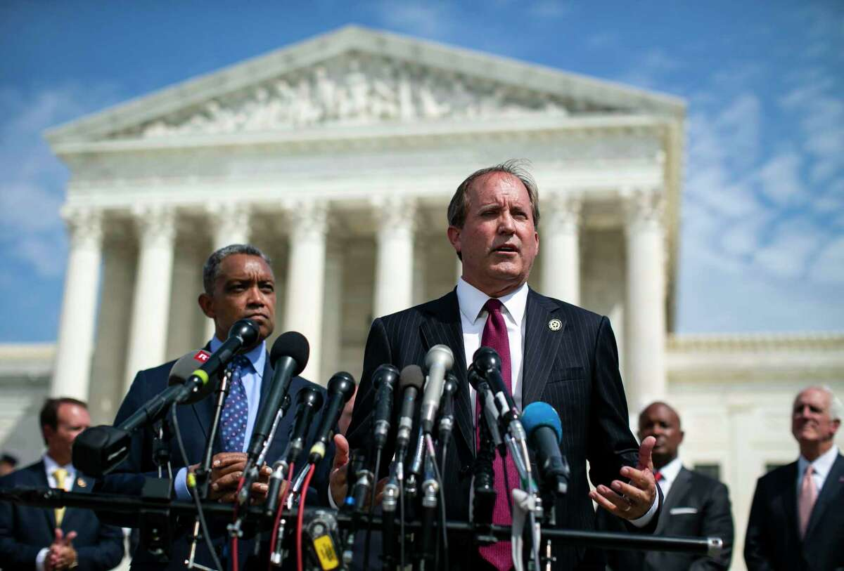Texas Attorney General Ken Paxton speaks at a news conference as District of Columbia Attorney General Karl Racine, left, and other state attorneys general look on, outside the Supreme Court in Washington, Sept. 9, 2019. In a petition filed in Texas state court of Travis County, Google, along with its parent company Alphabet, sought a protective order against Paxton, who is spearheading the multistate antitrust investigation into the company. (Al Drago/The New York Times)