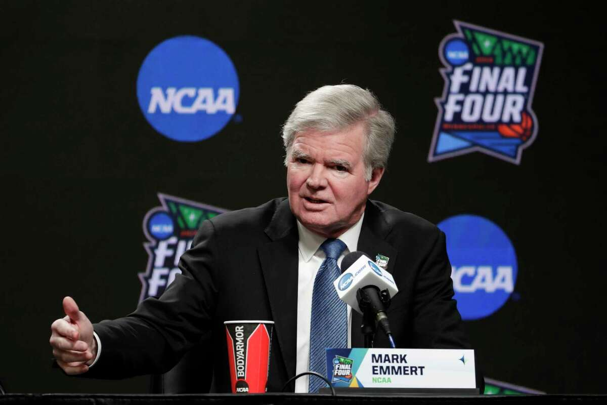 FILE - In this April 4, 2019, file photo, NCAA President Mark Emmert answers questions at a news conference at the Final Four college basketball tournament in Minneapolis. As Congress considers whether to allow college athletes to receive endorsement money, the NCAA and its allies spent nearly $1 million last year lobbying lawmakers to shape any reforms to the organization's liking.