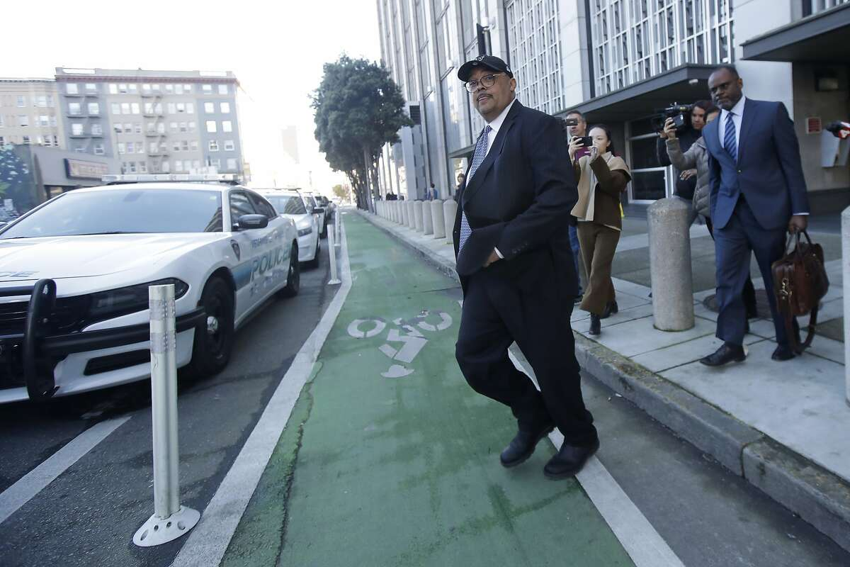 Mohammed Nuru, director of San Francisco Public Works, center, walks in front of attorney Ismail Ramsey as they leave a federal courthouse in San Francisco, Thursday, Feb. 6, 2020. (AP Photo/Jeff Chiu)