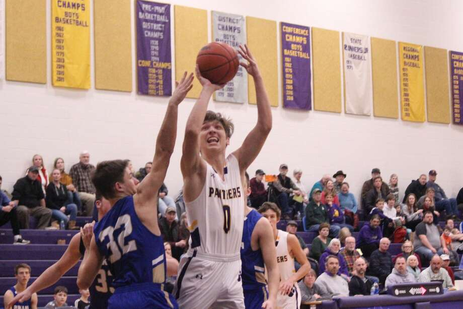 Jack Stefanski attacks the basket during the first quarter of Frankfort's loss to Onekama. Photo: Robert Myers