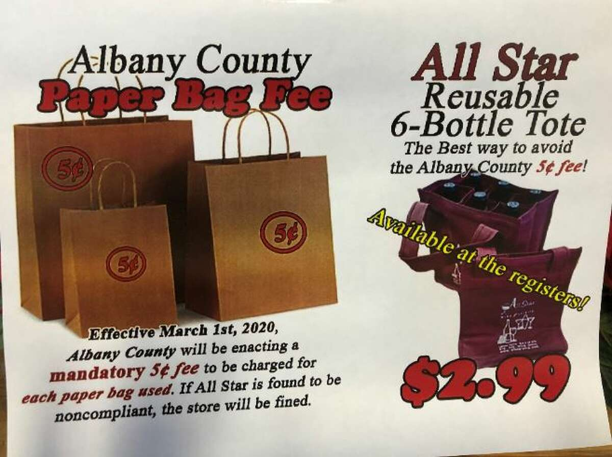 All Star Wine & Spirits has put up a poster explaining the new fee/tax imposed by Albany County.