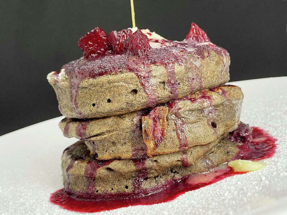 Gluten-free buckwheat pancakes with berry syrup are part of the daytime menu at Full Belly Cafe and Bar, which is reopening Oct. 5 in Stone Oak. Photo: Mike Sutter /Staff File Photo