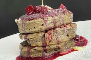 Gluten-free buckwheat pancakes with berry syrup are part of the breakfast menu at Full Belly Cafe and Bar.