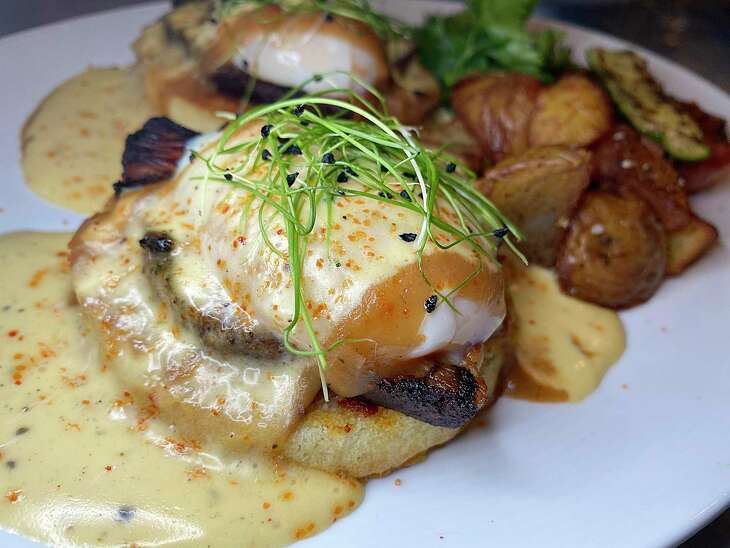 Eggs Benedict with espresso pork belly and hollandaise sauce is part of the menu at Full Belly Cafe and Bar, which is reopening Oct. 5 in Stone Oak.