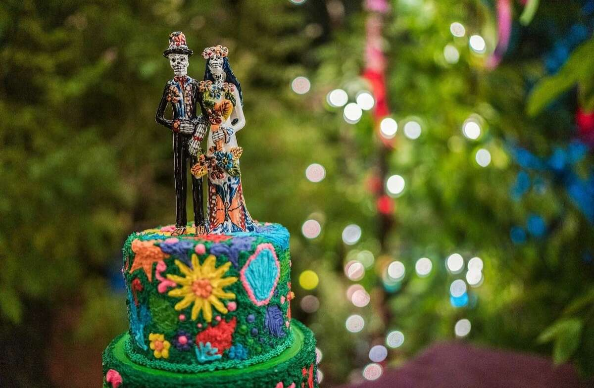 The skeleton-themed cake topper was part of the Día de los Muertos vibe at the wedding.