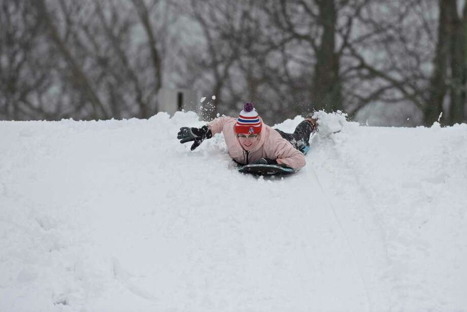 Callie Emmans, of Danbury, takes off down a hill on the first hole of Richter Park Golf Course after another snowstorm hits greater Danbury, Conn. Tuesday, March 13, 2018. Photo: H John Voorhees III / Hearst Connecticut Media / The News-Times