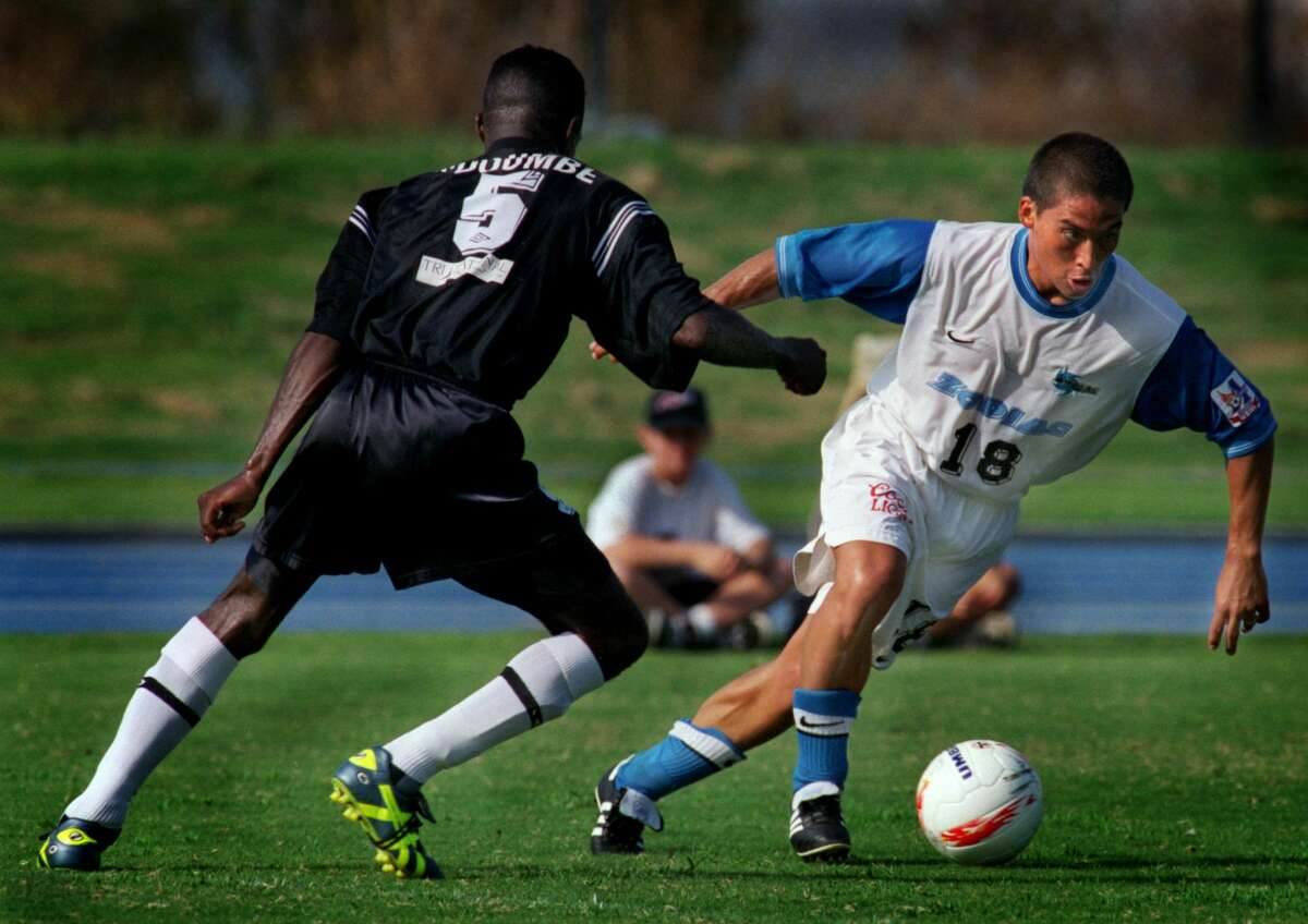 Forward Eddie Soto for the Orange County Zodiac team dribbles past #5 Michael N'Doumbe, defender for the San Diego Flash in a USL A-League game at UC Irvine in 1998.