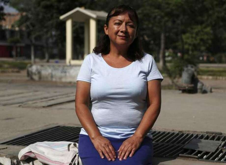 In this Feb. 6, 2020, photo, Peruvian Margarita Del Pilar Fitzpatrick, poses for a portrait at San Martin de Porres neighborhood in Lima, Peru. The day Fitzpatrick applied for an Illinois driver's license upended her life. When a clerk offered to register her to vote, the Peruvian citizen mistakenly accepted, leading to long legal battles and eventually deportation. Photo: Photo: Martin Mejia, AP