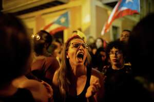 SAN JUAN, PUERTO RICO - JANUARY 20: Protestors demand the resignation of Governor Wanda Vázquez Garced during new protests in front of the governor's mansion on January 20, 2020 in San Juan, Puerto Rico. Residents are protesting after a warehouse full of relief supplies, reportedly dating back to Hurricane Maria in 2017, were found having been left undistributed to those in need. (Photo by Jose Jimenez/Getty Images)
