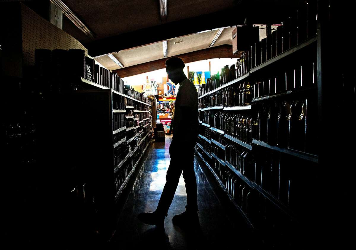 Customers shop in the dark at La Tapatia Market in Napa in 2019 during a PG&E public safety shut-off. More such outages are possible Sunday and Monday, though at the moment they are not forecast for the Bay Area.