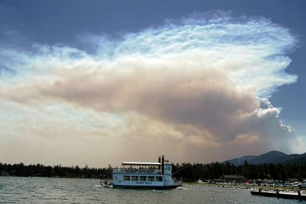 The Sierra Belle pulls away from the dock on Big Bear Lake in California.