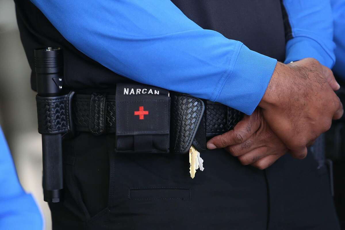 Narcan and other tools are seen on the belt of a BART ambassador at BART's Lake Merritt Station on Monday, February 10, 2020 in Oakland, Calif.