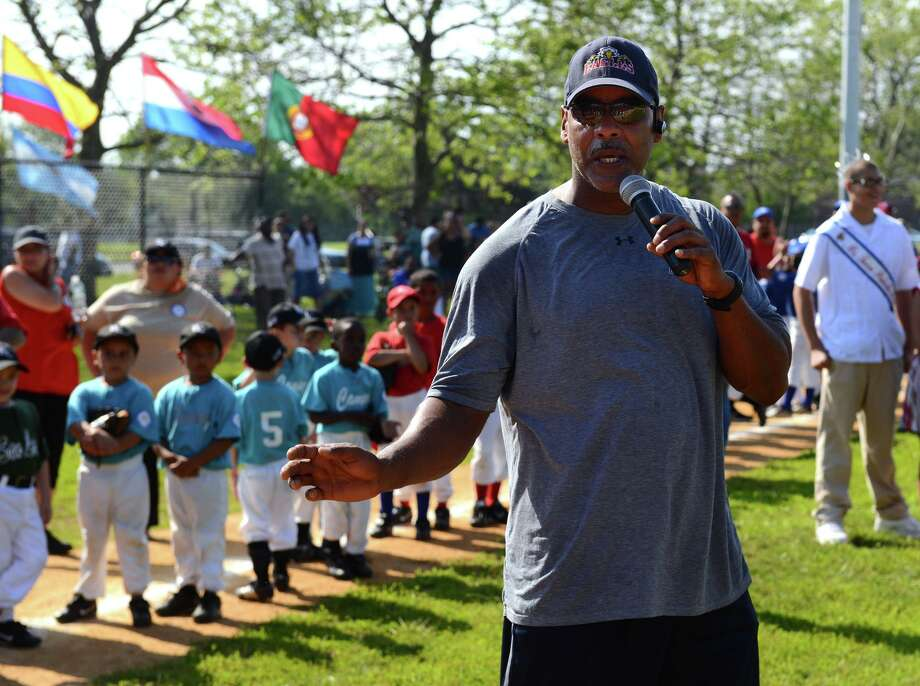 Bridgeport native and former pro baseball player Angel Echevarria speaks during the Bridgeport Caribe Youth Leaders' Caribe Day event at Seaside Park in Bridgeport,in 2013. Photo: Christian Abraham / Christian Abraham / Connecticut Post