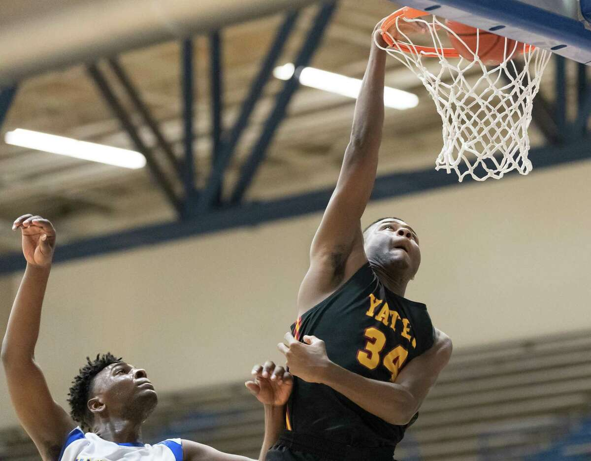 Marc-Anthony Batts (34) of the Yates Lions dunks the ball for a basket in the second half against the Washington Eagles in a High School basketball game on Tuesday, February 4, 2020 at Delmar Pavilion in Houston Texas.