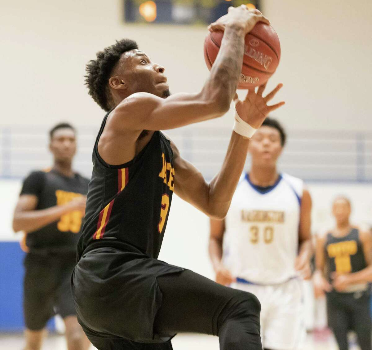 Antwon Norman (3) of the Yates Lions goes for a layup in the first half against the Washington Eagles in a High School basketball game on Tuesday, February 4, 2020 at Delmar Pavilion in Houston Texas.