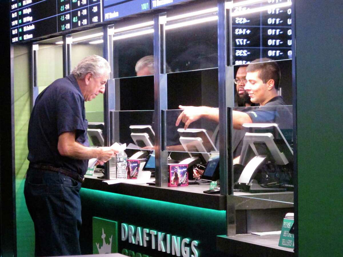 A man makes a sports bet at Resorts casino in Atlantic City, N.J. In November 2019, New Jersey's casinos and racetracks took in nearly $563 million worth of sports bets, a new monthly record.