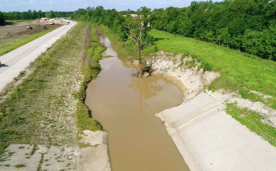 Levee damage from Tropical Storm Harvey at the Green Pond detention basin west of Fannett. The levee is part of the Taylor's Bayou master plan and Drainage District 6 expects repairs to begin in the next few months.  Photo taken Friday, 5/24/19 Photo: Guiseppe Barranco/The Enterprise, Photo Editor / Guiseppe Barranco ©