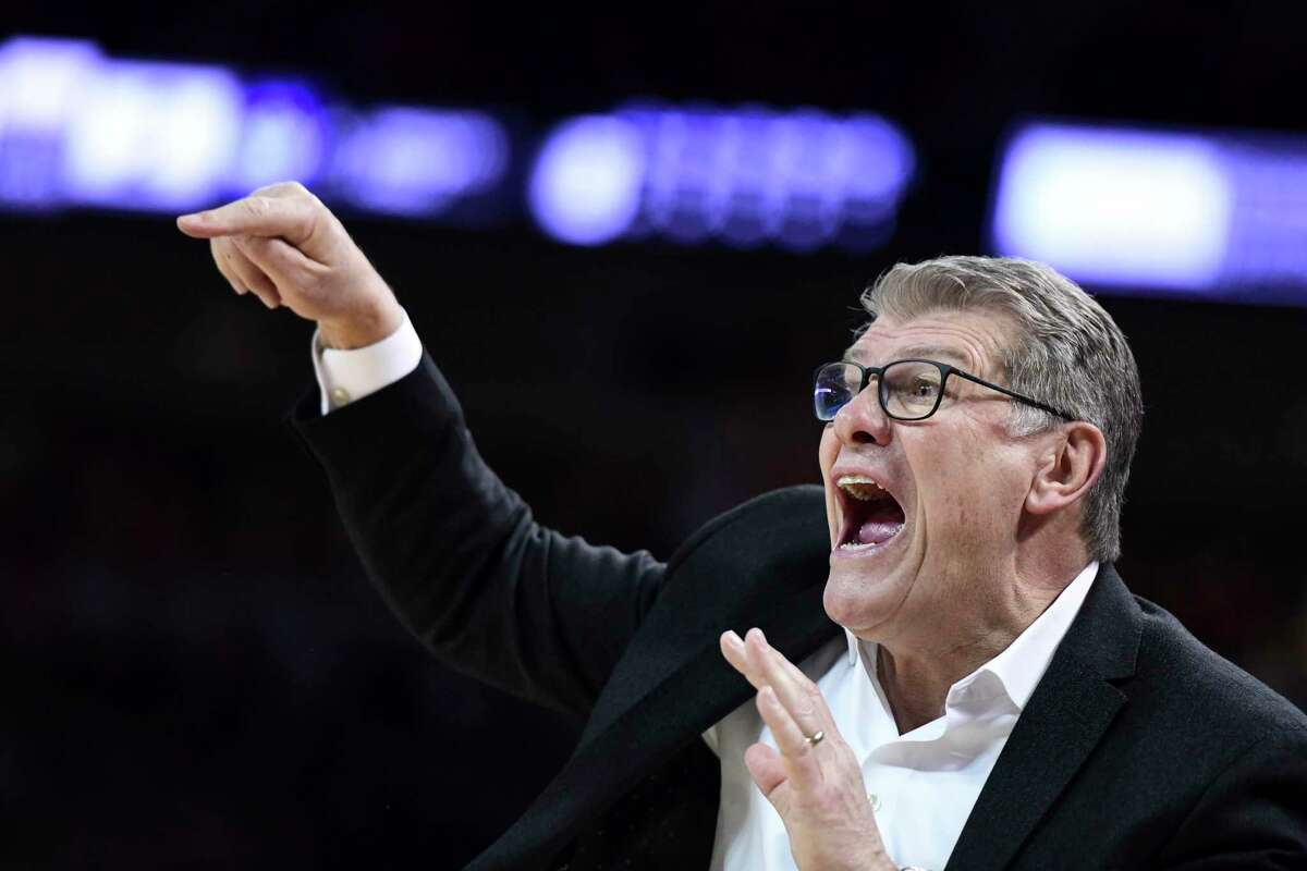 Connecticut coach Geno Auriemma communicates with players during the first half of an NCAA college basketball game against South Carolina, Monday, Feb. 10, 2020, in Columbia, S.C. (AP Photo/Sean Rayford)