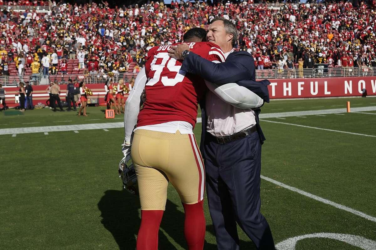 San Francisco 49ers defensive tackle DeForest Buckner (99) hugs general manager John Lynch after an NFL football game against the Pittsburgh Steelers in Santa Clara, Calif., Sunday, Sept. 22, 2019. (AP Photo/Tony Avelar)