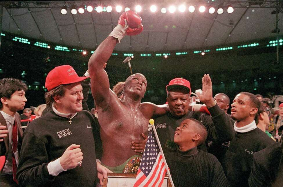 FILE - In this Feb. 11, 1990, file photo, heavyweight boxer James