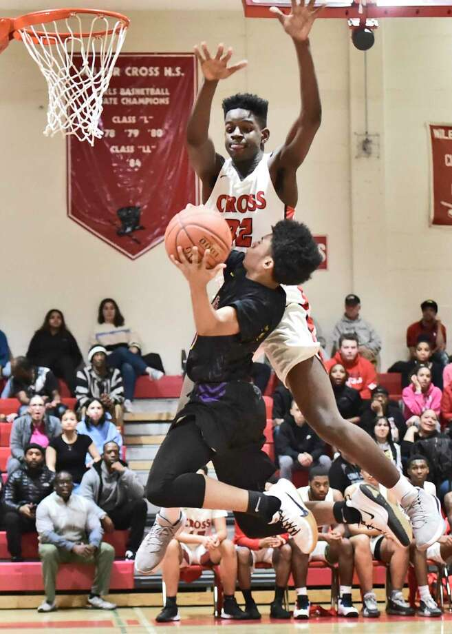 WIlbur Cross' Noah Rainge defends against Prince Tech's Tyshawn Jackson during the first quarter on Monday. Photo: Peter Hvizdak / Hearst Connecticut Media / New Haven Register