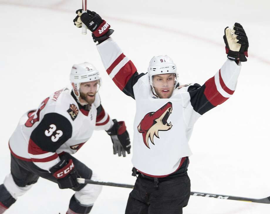 Coyotes left wing Taylor Hall (right) celebrates with Alex Goligoski after scoring against Montreal. Photo: Ryan Remiorz / Associated Press