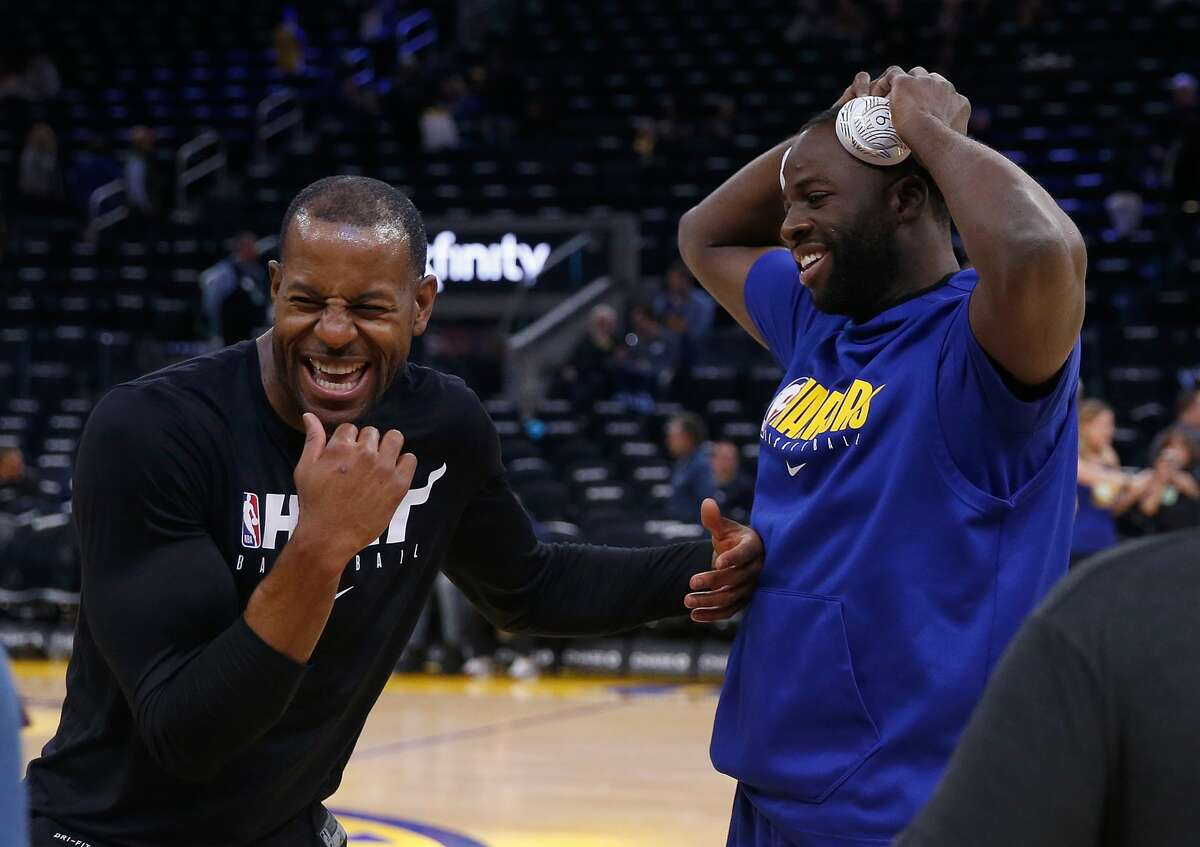 FILE - Andre Iguodala and Draymond Green chat prior to the Warriors-Heat game on February 10, 2020.