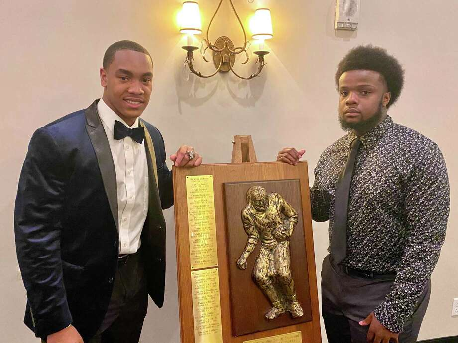 West Orange-Stark linebacker Tyrone Brown (left) and West Brook quarterback Troy Yowman (right) pose for a picture after winning the 28th annual Willie Ray Smith Awards on Monday night at the MCM Elegante Hotel in Beaumont. Photo: Matt Faye/The Enterprise