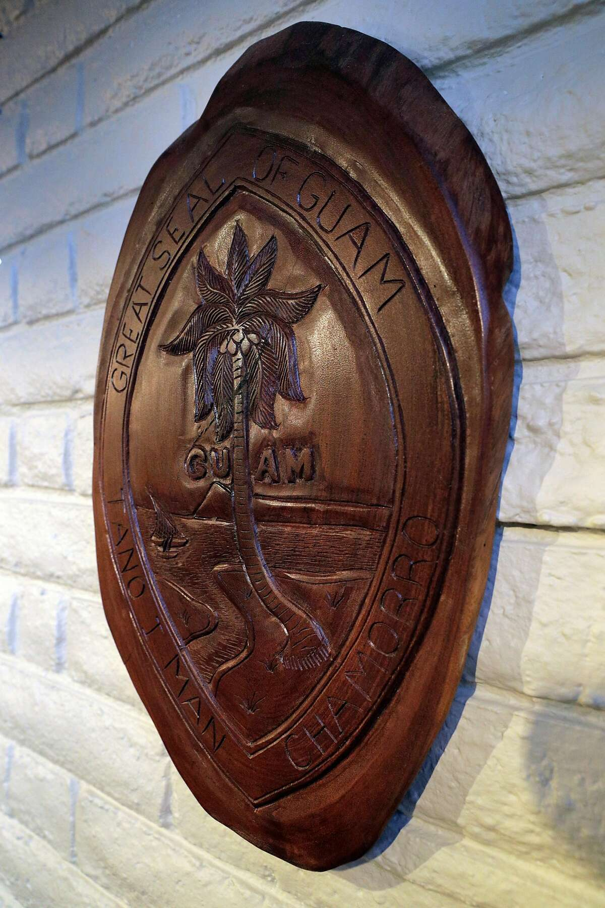 A hand-carved plaque with the Seal of Guam at Prubechu, a Guamanian restaurant that just reopened in the Mission in San Francisco, Calif., on Thursday, February 6, 2020.