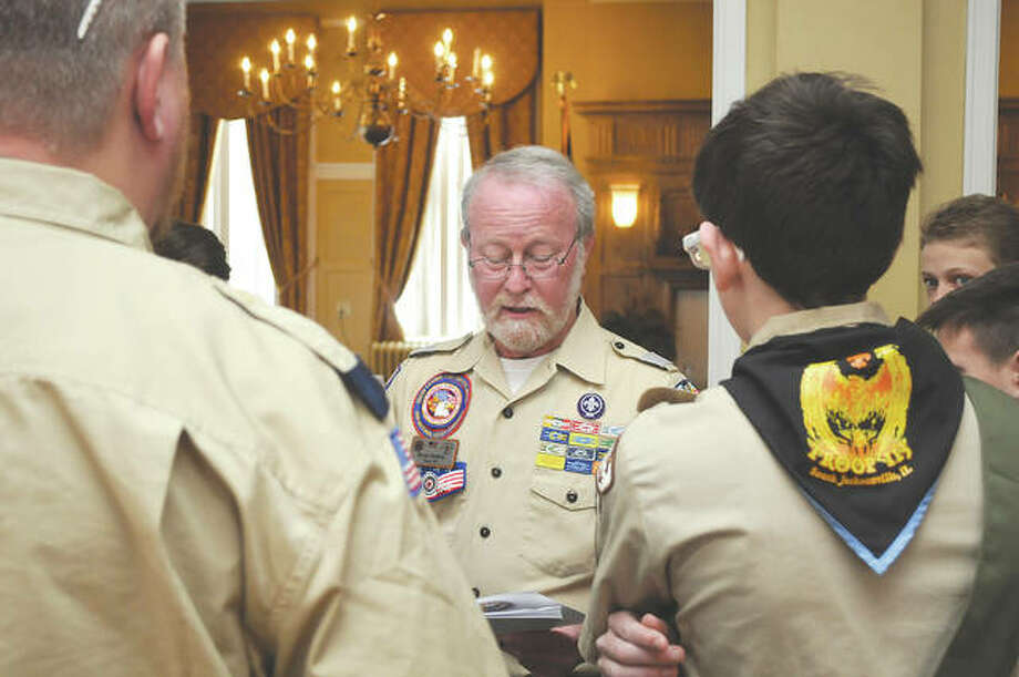 Bruce Selway, chairman of the Citizenship Day Commitee, stands Monday with Boy Scouts from several troops prior to their annual luncheon. Photo: Darren Iozia | Journal-Courier