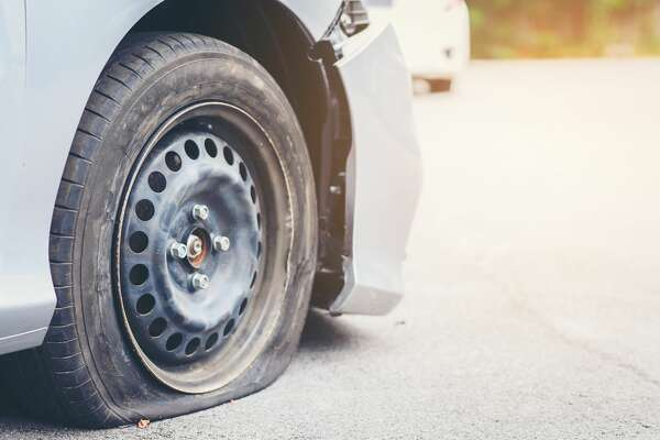 20 cars report flat tires along stretch of I-405.