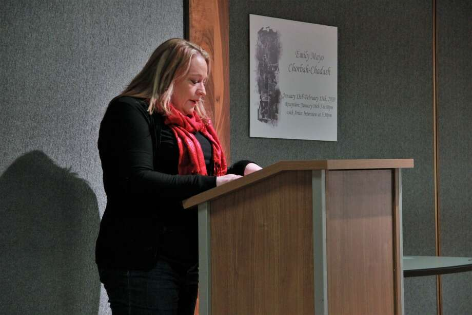 Area residents celebrated Valentine's Day early as they shared their favorite poem during Ferris' Open Mic Night on Monday.  Presented by the FSU Literature in Person Series, students and residents gathered at the Ferris State University Center to share their favorite poem or short prose in front of various audience members. The event was to celebrate and help define love of all kinds, including romantic, familiar, platonic, earthly, supernatural and even what is not love. The event was co-sponsored by the Literature in Person Series, which is supported by the Ferris Department of English, Literature, and World Languages. Photo: (Pioneer Photo/Alicia Jaimes)