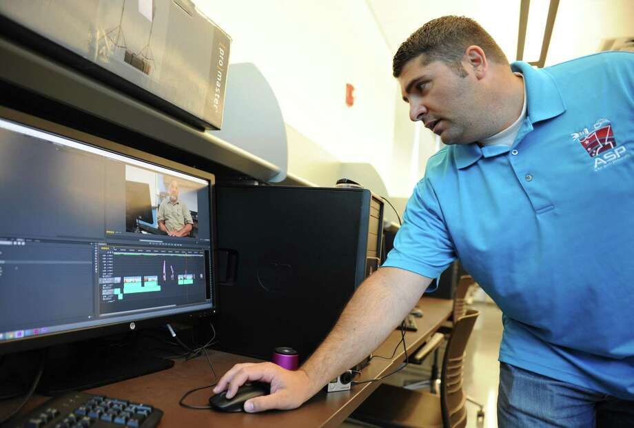 Digital Media Department Head Brian Ciancio shows the progress of his class's documentary video during a class at Wright Technical High School in Stamford, Conn. Wednesday, June 10, 2015. Photo: Tyler Sizemore / Staff Photographer / Greenwich Time