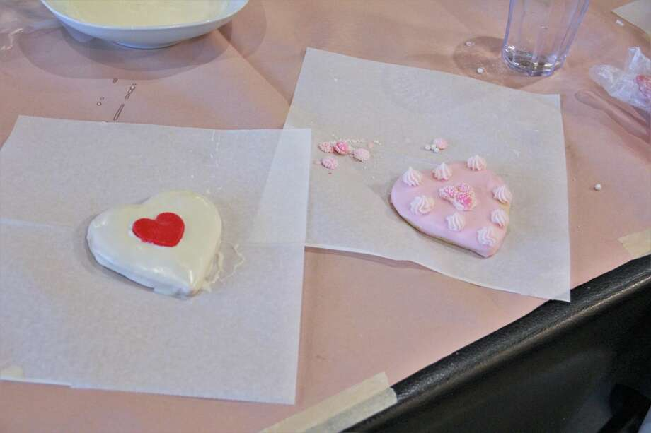 The smell of cookies filled the air as area residents made Valentine's Day treats for their special loved ones Monday night. In celebration of Festival of the Arts, guests gathered at Nawal's Mediterranean Grill to learn new cookie decorating techniques. Residents frosted heart-shaped cookies with pink and white designs, as well as learned to use stencils and various candy shapes for decoration. At the end of the event, people were able to bring their decorated cookies home. Photo: (Pioneer Photo/Alicia Jaimes)