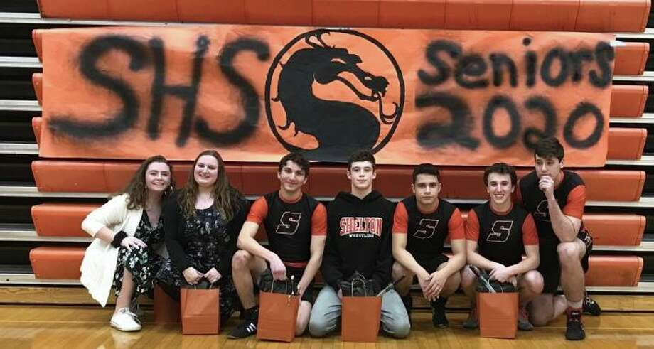 Manager Michelle Marty, manager Allison Dapp, Adam Rossetti, Garrett Ziperstein, Christian Olavarria, Chris Cavagnuolo and Brady Havee were honored on Senior Night. Photo: Bill Bloxsom / Hearst Connecticut Media / Shelton Herald