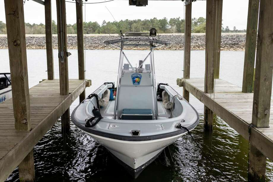 A Montgomery County Precinct 1 Constable's lake patrol boat stays ready even during the off-season near Lake Conroe, Wednesday, Feb. 5, 2020. Constable's continue to stay on standby throughout all seasons of weather. Photo: Gustavo Huerta, Houston Chronicle / Staff Photographer / Houston Chronicle