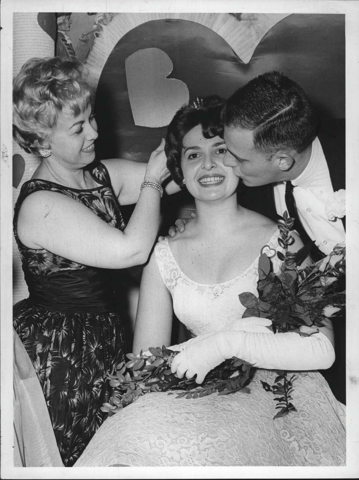 Crossroads Restaurant, Latham, New York - Valentine Queen, Beta Sigma Phi - Miss Carol Bratton, Chairman of Affair, Mrs. Jan Holick, Queen, Jan Holick Undated (husband). February 21, 1962 (Thomas Sheehan/Times Union Archive)