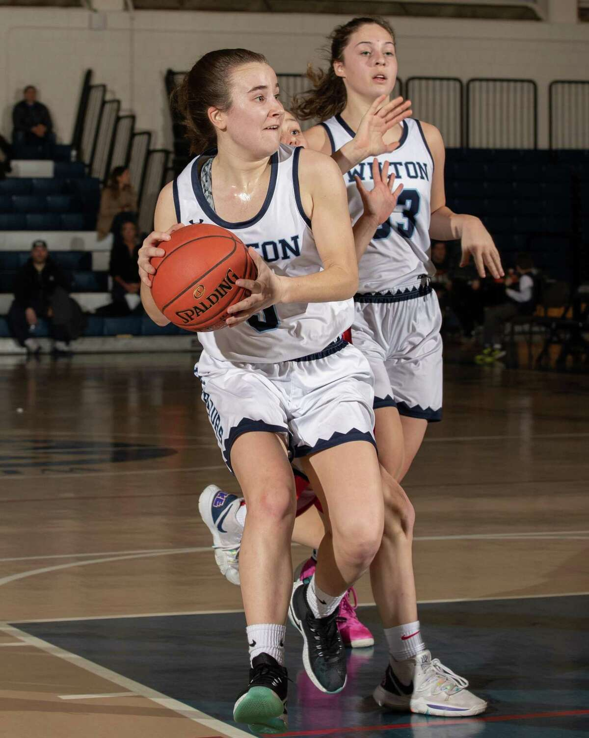 Zoe Rappaport looks to make a pass during Wilton's game against Greenwich on Monday night.