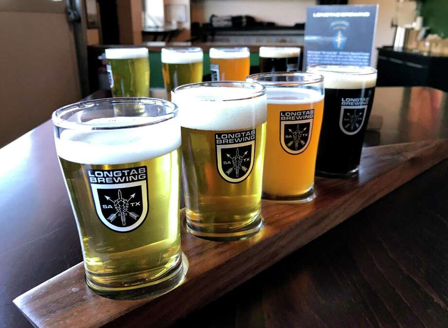 A flight of beer from Longtab Brewing Co. Photo: Paul Stephen / Staff