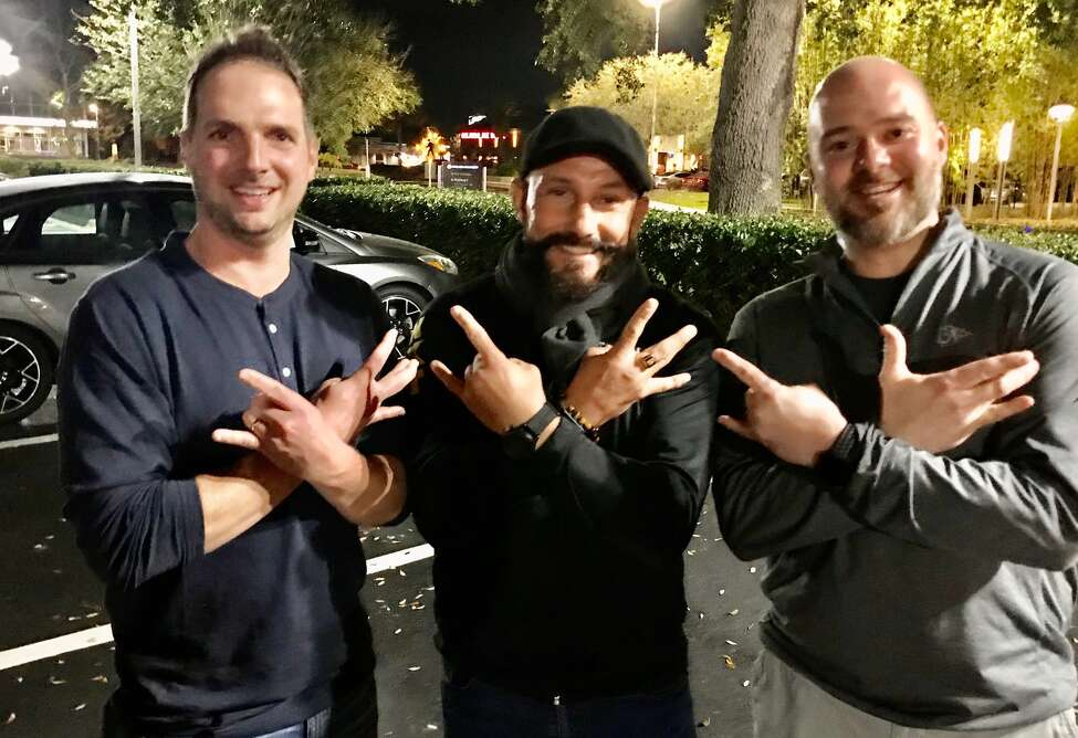Jeff Pollard, left, of Saratoga Springs, makes the Undisputed Era wrestling sign with WWE pro wrestler Bobby Fish, center, and Dave Hruby, of Delmar, after a recent NXT match in Winter Garden, Fla.