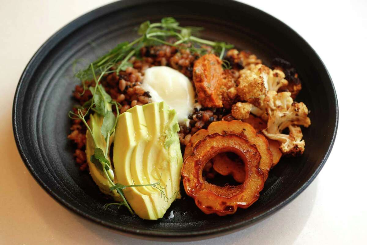 Power Bowl with romesco, grains, avocado, roasted squash and cauliflower, and a poached egg at the new Terrace 54 Bar + Table in the West Houston Medical Center,.