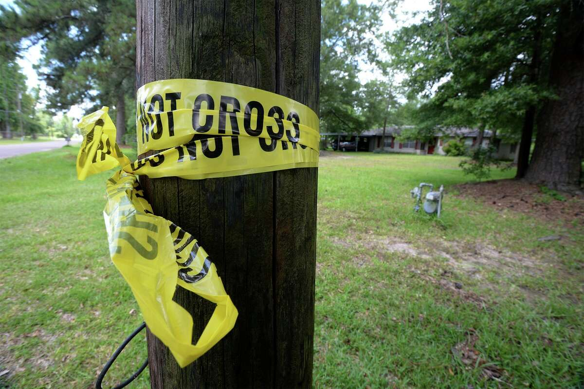 Crime scene tape is wrapped around a pole at the north Vidor home were a man and woman were found murdered late Thursday night. The victims were both in their 80s and their names have not been released by police. Photo taken Friday, June 12, 2015 Guiseppe Barranco/The Enterprise