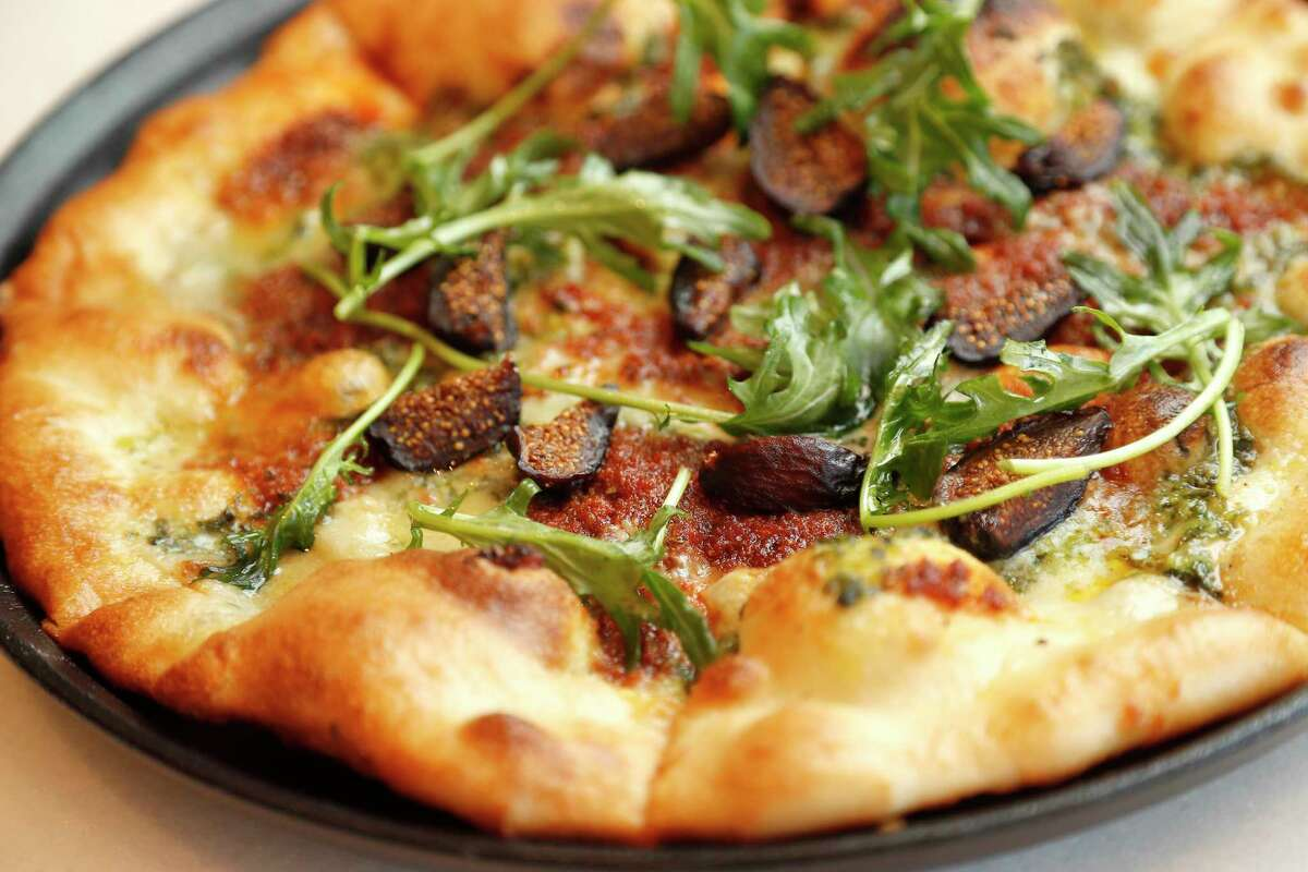 Smokey fig pizza with mission figs, smokey blue cheese, watercress pesto, chorizo, lemon vinaigrette and arugula at the new Terrace 54 Bar + Table in the West Houston Medical Center,.