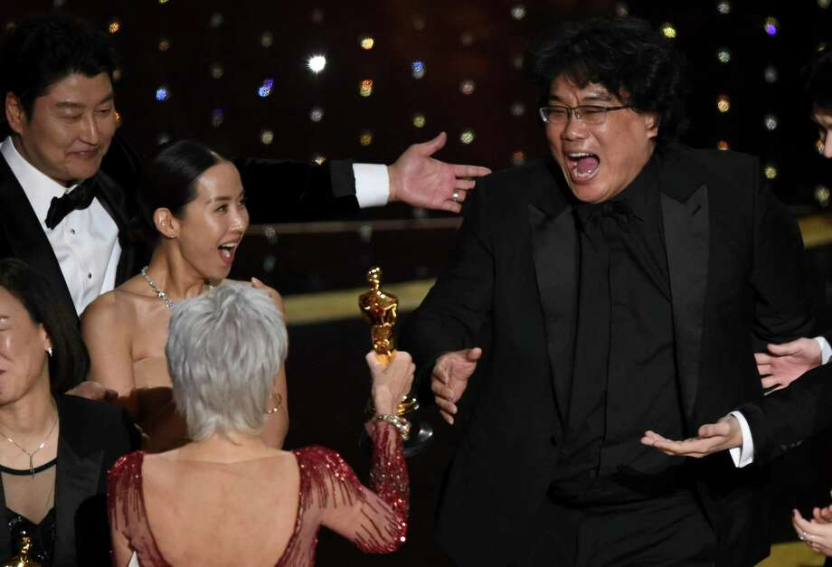 "Bong Joon Ho, right, reacts as he is presented with the award for best picture for ""Parasite"" from presenter Jane Fonda at the Oscars on Sunday, Feb. 9, 2020, at the Dolby Theatre in Los Angeles. Looking on from left are Kang-Ho Song and Kwak Sin Ae.(AP Photo/Chris Pizzello) Photo: AP Photo/Chris Pizzello / Chris Pizzello/Invision/AP / Invision"