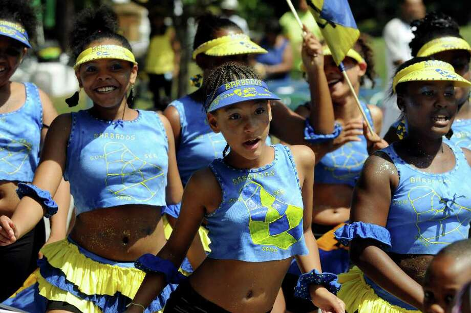 Selvanna Kearney, 10, center, dances with the Barbados Beauties in the costume parade during Carama 2010 Caribbean Festival on Saturday, Aug. 14, 2010, at Central Park in Schenectady, N.Y. (Cindy Schultz / Times Union) Photo: Cindy Schultz