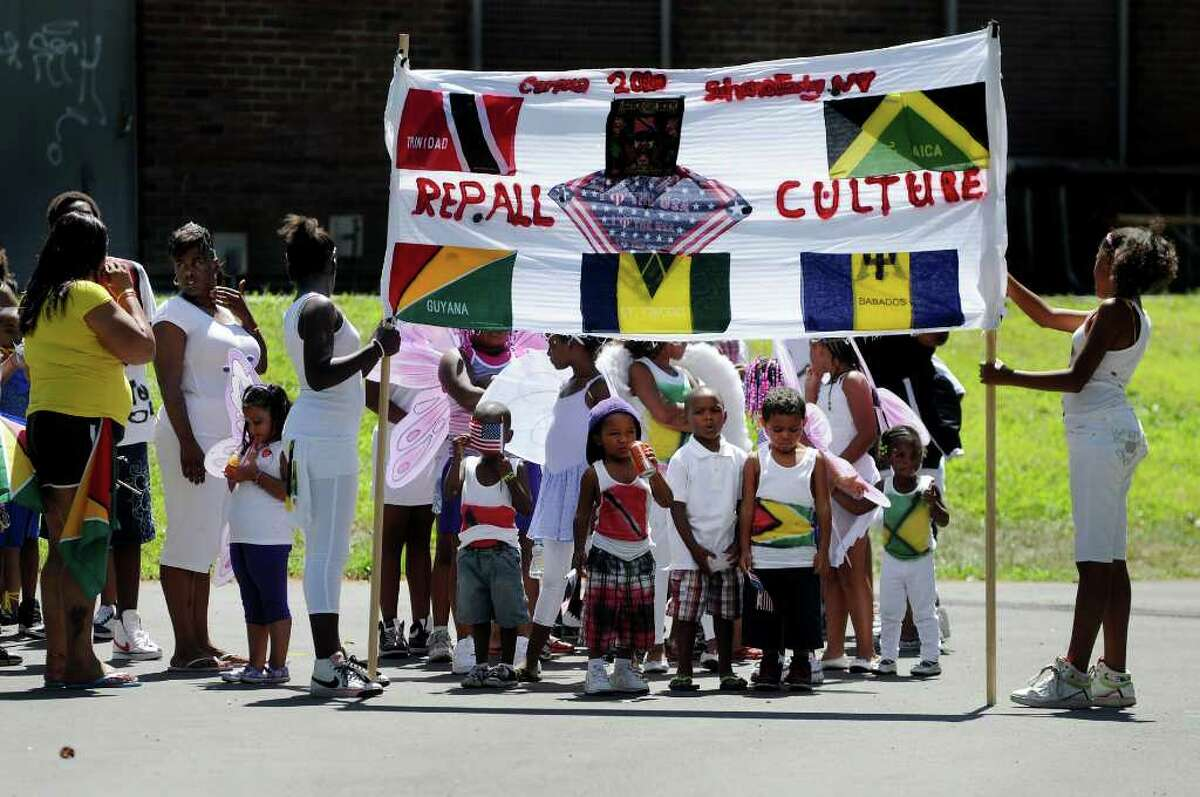 Participants line up for the costume parade during Carama 2010 Caribbean Festival on Saturday, Aug. 14, 2010, at Central Park in Schenectady, N.Y. (Cindy Schultz / Times Union)