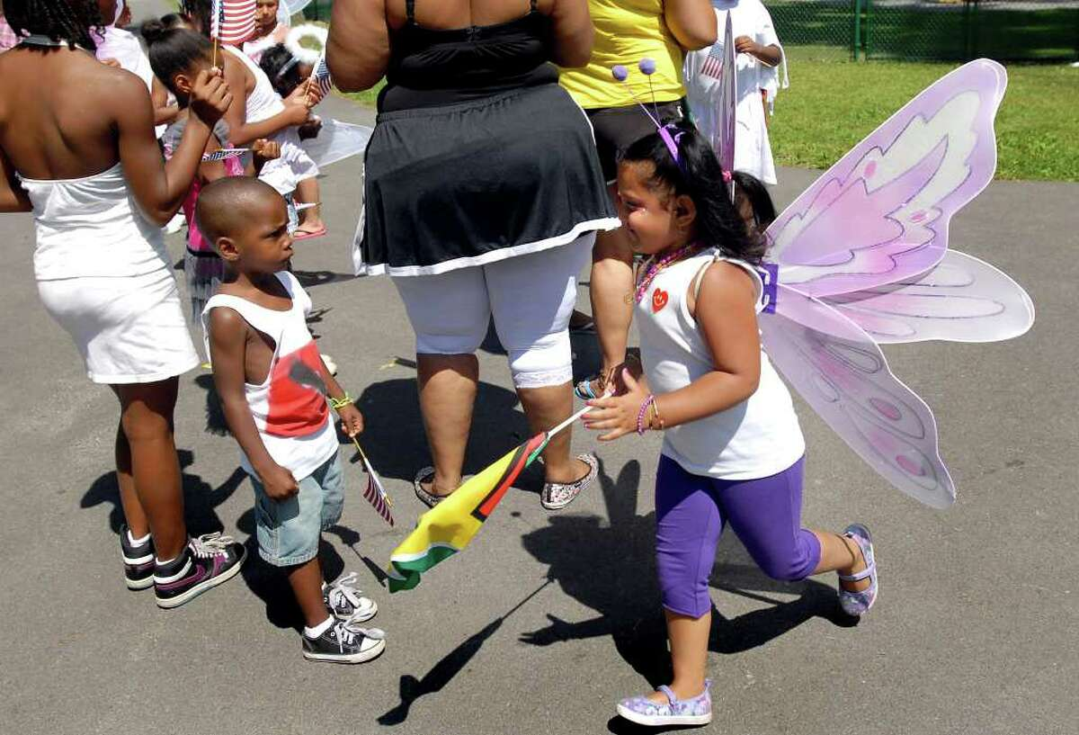 Aaliyah DeSilva, 5, of Schenectady, right, gets ready for the costume parade during Carama 2010 Caribbean Festival on Saturday, Aug. 14, 2010, at Central Park in Schenectady, N.Y. (Cindy Schultz / Times Union)